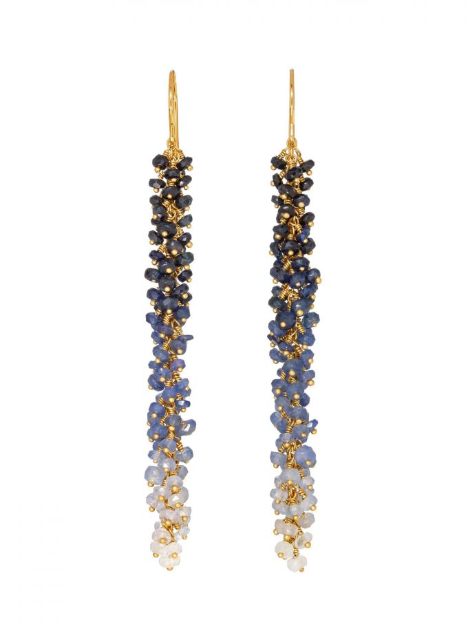 Photo of Catkin earrings, sapphire earrings with ombre effect and gold. On white background