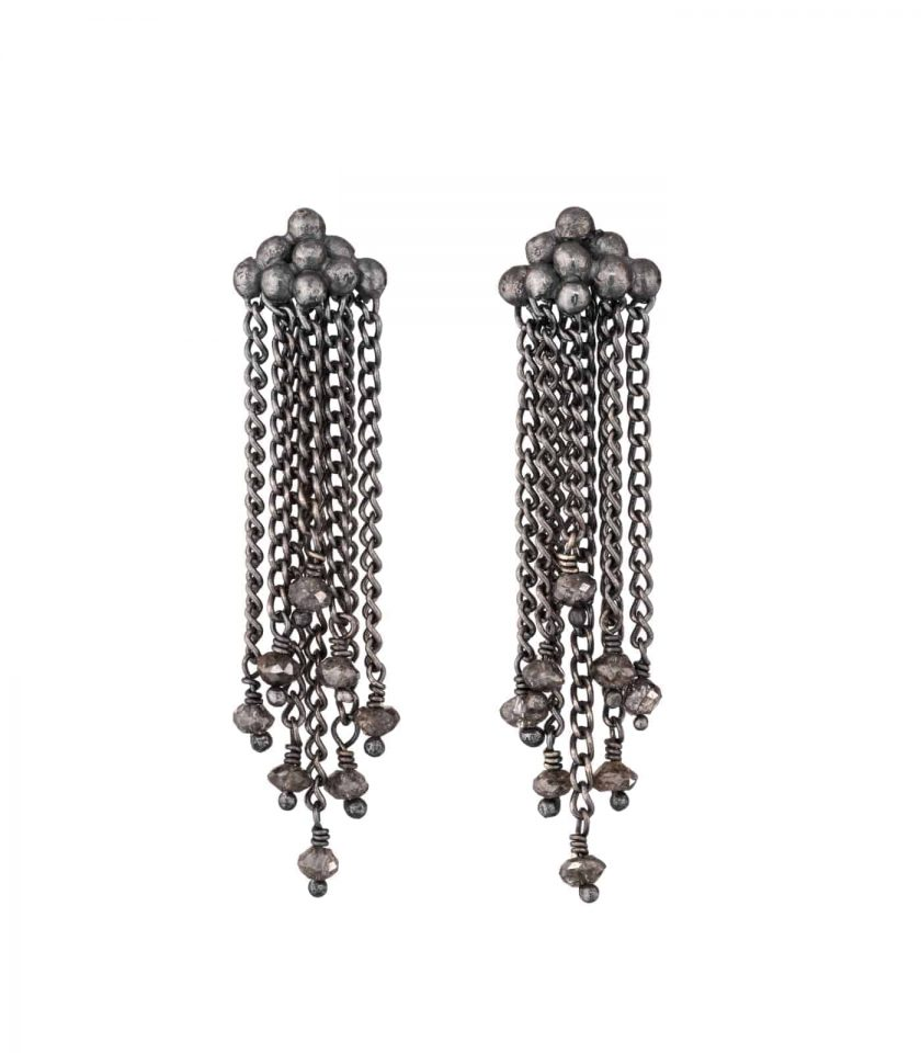 Photo of diamond and oxidised silver chain earrings on white background