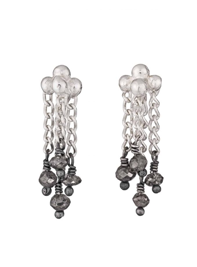 Photo of diamond and silver chain earrings on white background