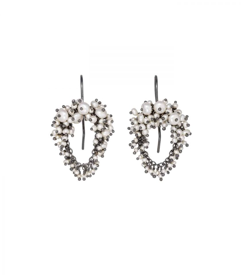 Photo of pearl and oxidised silver beaded earrings on white background