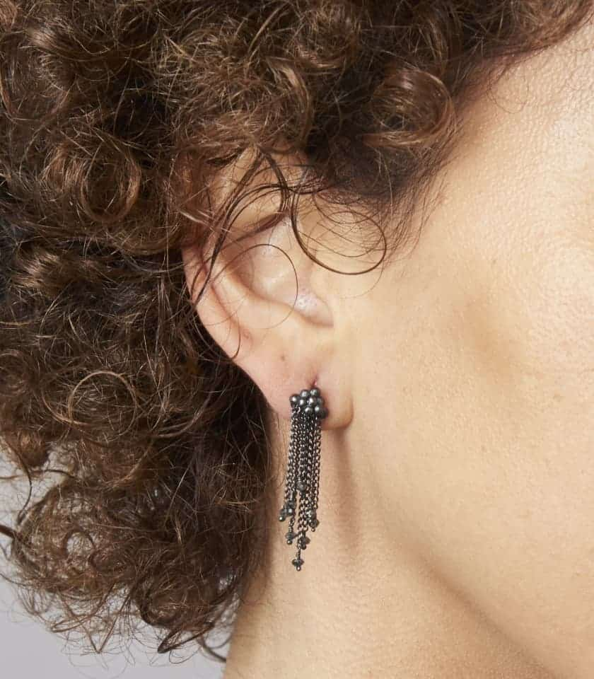 Model wearing oxidised silver and diamond earrings