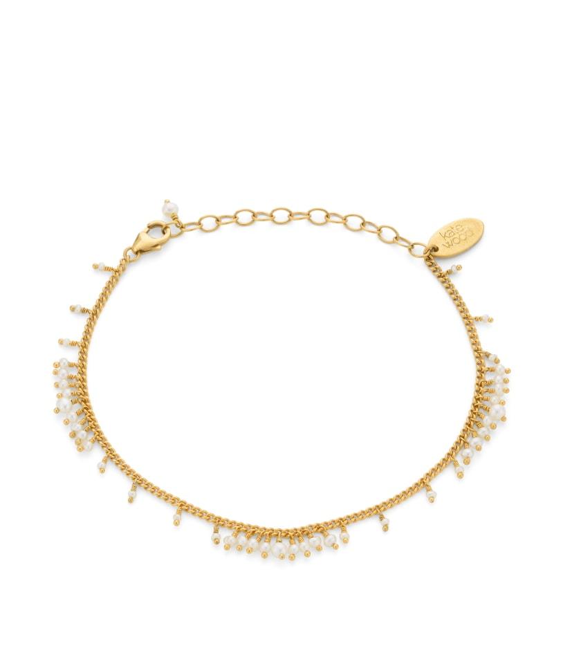 Pearl bracelet on gold vermeil curb chain.