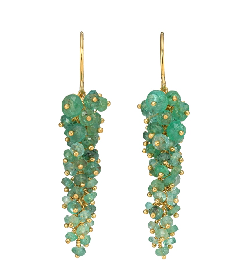 Photo of green emerald earrings with gold chain on white background